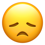 How Disappointed Face emoji looks on Apple.