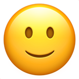 How Slightly Smiling Face emoji looks on Apple.