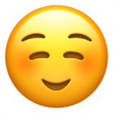 How Smiling Face emoji looks on Apple.