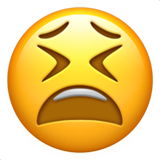How Tired Face emoji looks on Apple.