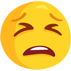 How Tired Face emoji looks on Messenger.