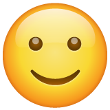 How Slightly Smiling Face emoji looks on Whatsapp.