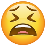 How Tired Face emoji looks on Whatsapp.